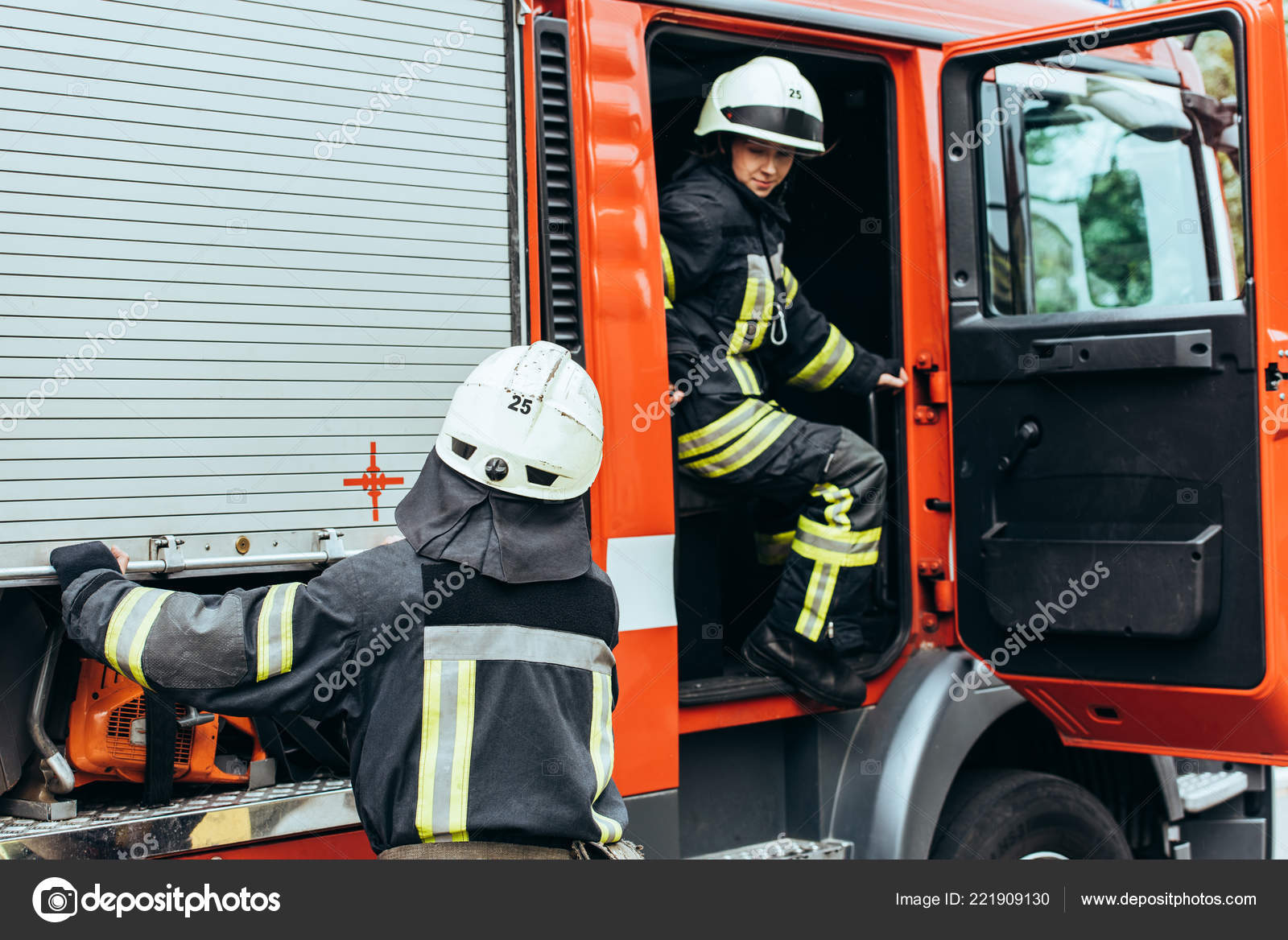depositphotos 221909130 stock photo partial view firefighters helmets fire